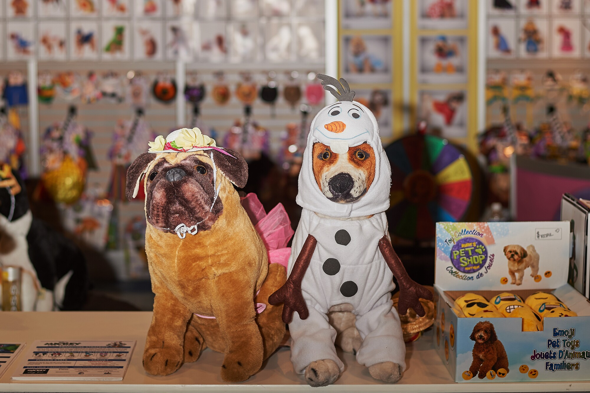 Pet costumes are displayed on stuffed dogs at the Global Pet Expo in Orlando, Fla.
