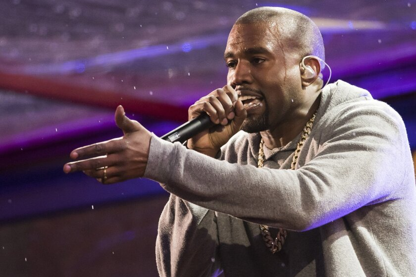 FILE - In this Dec. 1, 2014 file photo, Kanye West performs during the World AIDS Day (RED) concert In Times Square in New York.