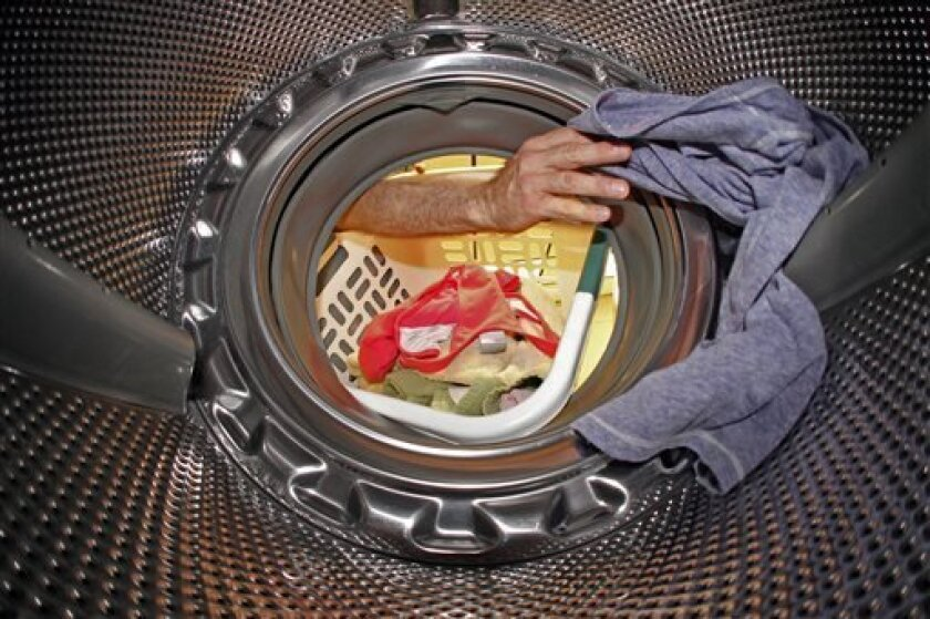 A perfectly legal load of laundry is loaded into a whirlpool washing machine.