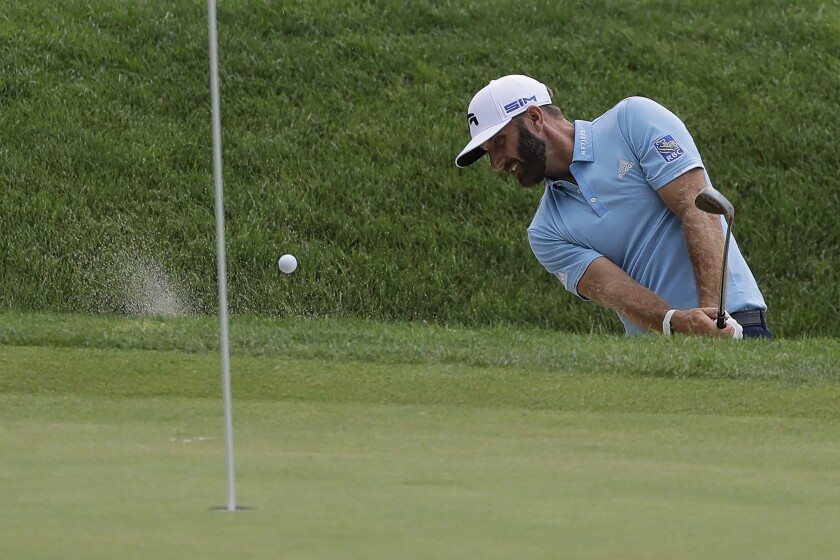 Dustin Johnson hits out of a bunker onto the 16th green during the final round of the Travelers Championship.