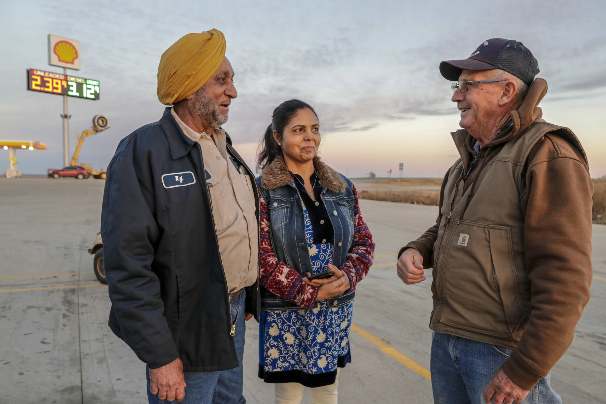 Truck Stop 40 owners Raj Chhoker, left, and his wife, Harpreet Chhoker, chat with their neighbor Kenny Drake.