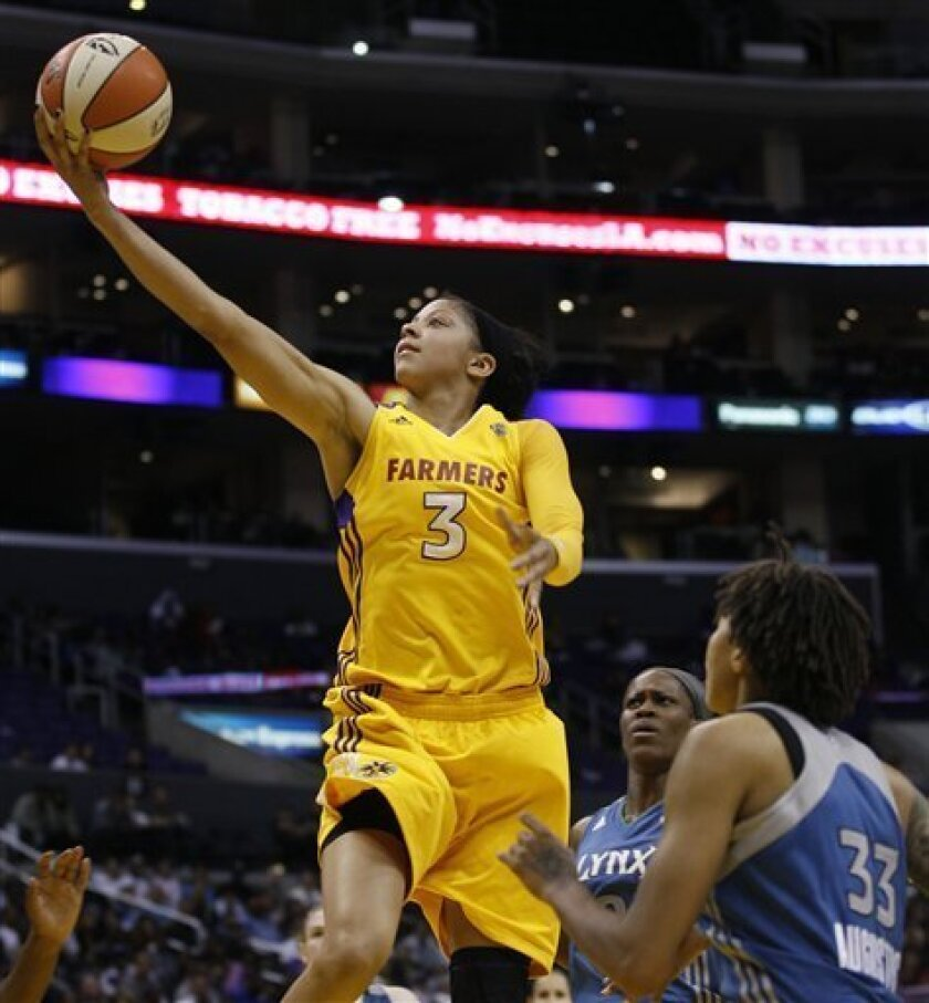 Los Angeles Sparks forward Candace Parker (3) scores over Minnesota Lynx's Seimone Augustus (33) during the second half of a WNBA basketball game in Los Angeles, Friday, June 3, 2011. The Sparks beat the Lynx 82-74. (AP Photo/Lori Shepler)