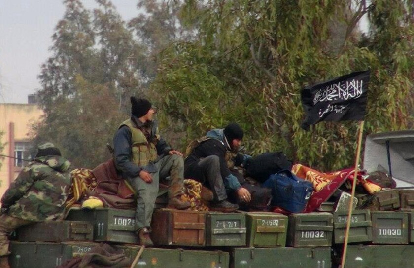 Al Qaeda group in Iraq unites with extremists in Syria