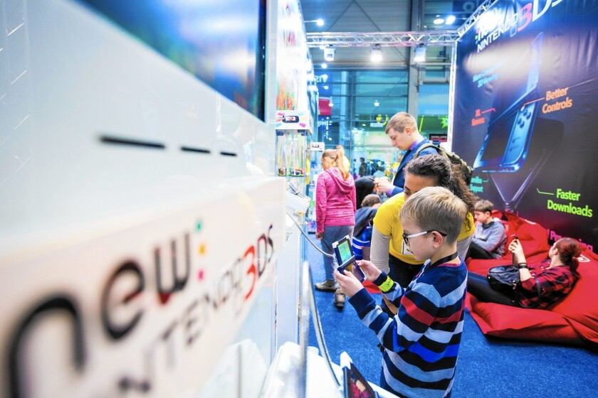 Nintendo Wii sales fell from 24.19 million units in 2008 to 530,000 last year. Above, a boy plays a Nintendo game at a trade fair in Poznan, Poland, this month.