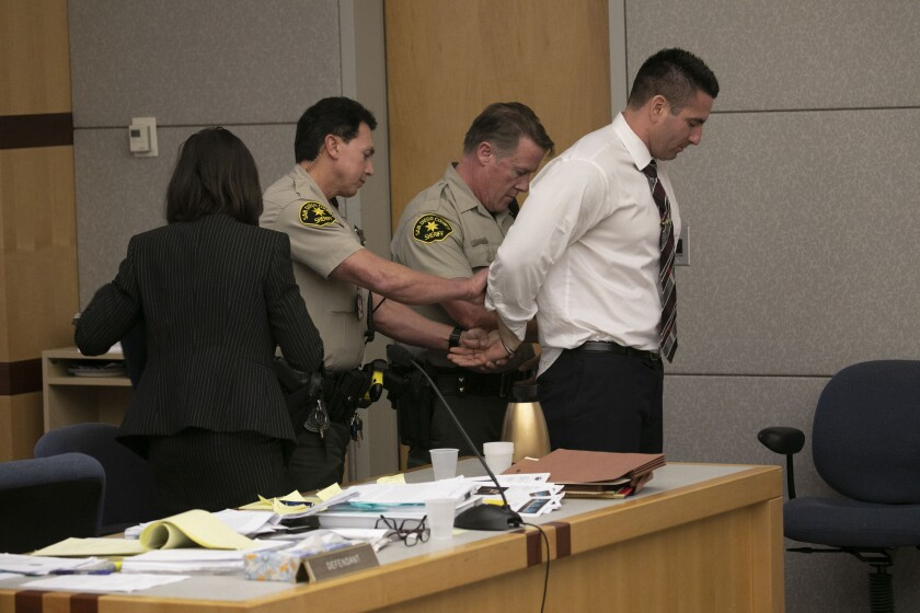 In this photo from Dec. 10, former San Diego County Sheriff Deputy Richard Fischer is taken in to custody after he was sentenced to 44 months in jail and 16 months of supervised release for having unethical contacts with women while on duty after a plea deal was brokered on the eve of his trial. The hearing was in San Diego Superior court in Vista.