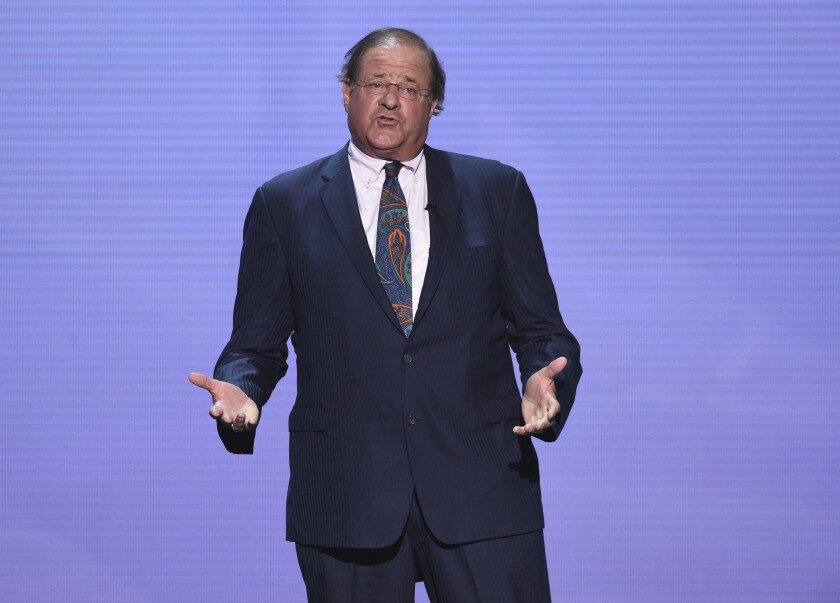 """File-This July 18, 2018, file photo shows shows Chris Berman appearing at the ESPY Awards at Microsoft Theater in Los Angeles. Berman will continue to host """"NFL PrimeTime"""" after agreeing to a new contract with ESPN. The multi-year agreement was announced on Monday, May 10, 2021, which is Berman's 66th birthday. """"We've been working on it for awhile and this was the perfect time to do it,"""" Berman said during a telephone interview. """"ESPN has been almost two-thirds of my life. I'm honored that what I do still works.""""(Photo by Phil McCarten/Invision/AP, File)"""
