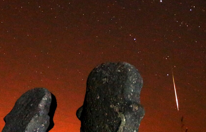 A meteor streaks across the sky during the Perseid meteor shower at the Maculje archaeological site near Novi Travnik in the early morning of August 13, 2015.