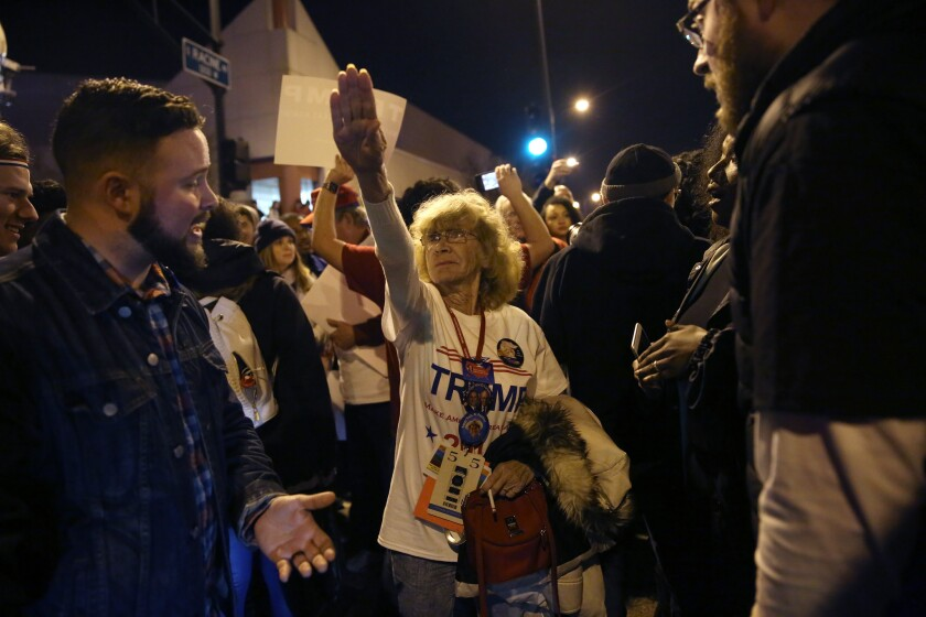 Donald Trump supporter Birgitt Peterson, center, of Yorkville, argues with protesters on March 11, 2016, outside the UIC Pavilion after the rally for the Republican presidential candidate was canceled.