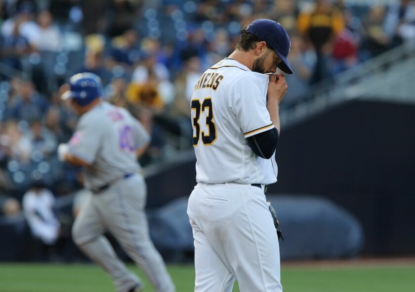Padres pitcher James Shields wipes his face as Mets' Bartolo Colon rounds the bases after hitting a two-run homer.