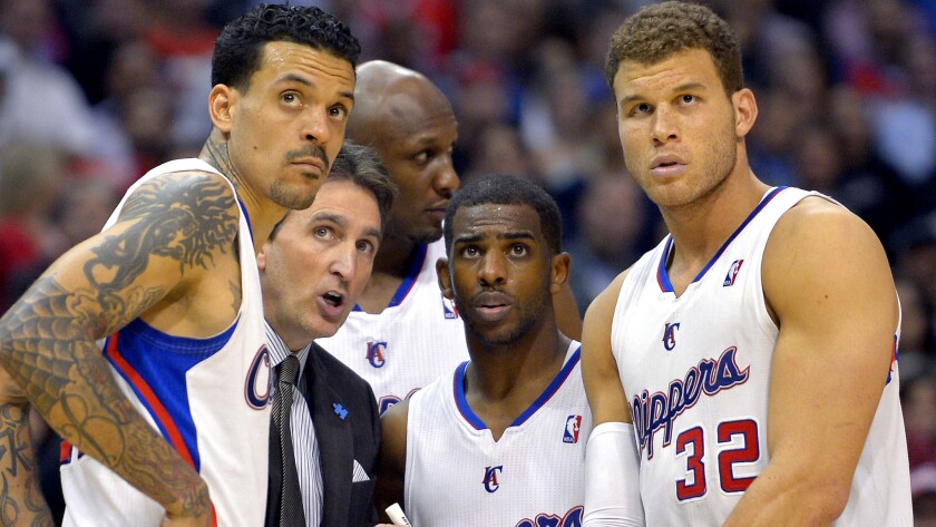 Lamar Odom, rear center, was part of the 2012-13 Clippers team along with, from left, Matt Barnes, Coach Vinny Del Negro, Chris Paul and Blake Griffin.