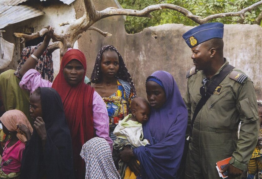 A photo released by the Nigerian army shows women and children rescued in the Sambisa Forest on April 28 in an operation against Boko Haram.