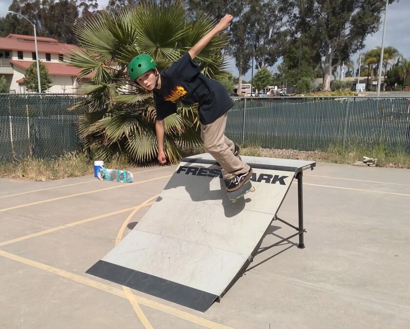 Olive Peirce Middle School seventh-grader Kaden Jackson, 13, shows off his skills at Ramona Skatepark Champions' skatepark.