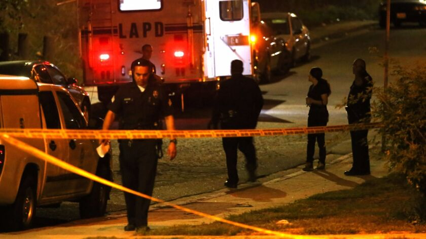 LOS ANGELES, CA - OCTOBER 28, 2015 -- Police officers oversee the crime scene where the bodies of tw