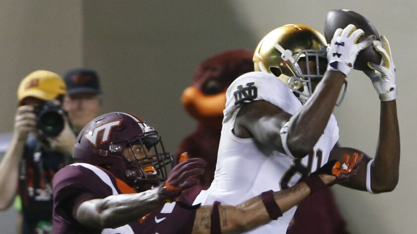 Notre Dame wide receiver Miles Boykin (81) makes a catch over Virginia Tech defensive back Jovonn Quillen (26) during the second half on Saturday. Notre Dame won 45-23.