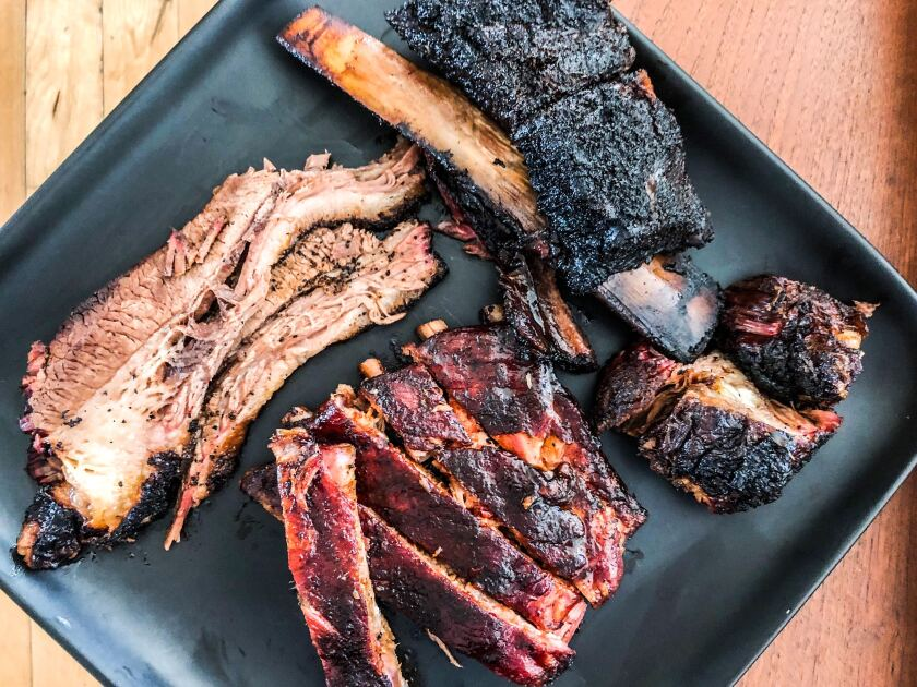 Brisket, pork ribs and beef rib from Ragtop Fern's BBQ.