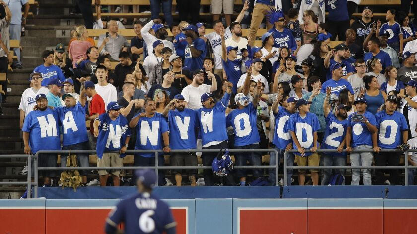 LOS ANGELES, CALIF. -- MONDAY, JULY 30, 2018: Dodgers fans spell out Mannywood 2.0 as Dodgers four-t