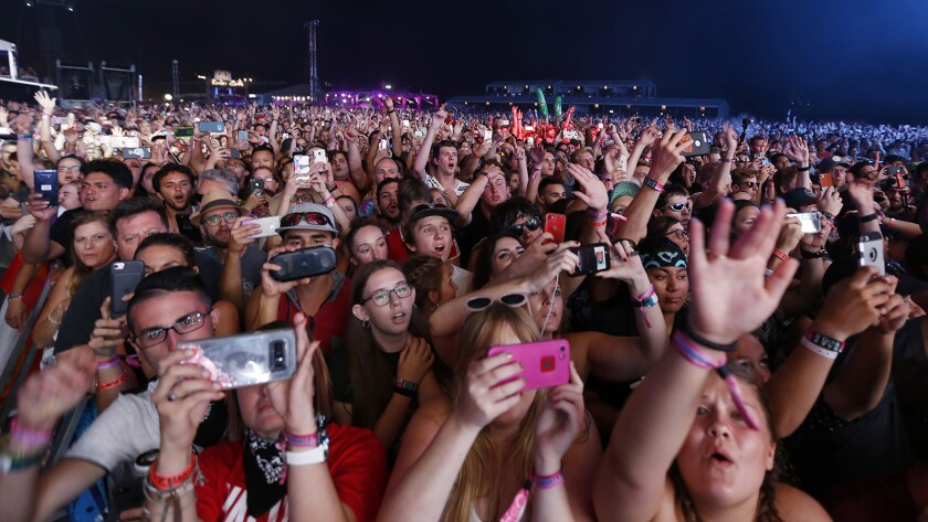 The majority of millennials who plan to leave San Diego County cite housing costs. Pictured: Fans cheer on the band Imagine Dragons at KAABOO Del Mar on Saturday, September 15, 2018.