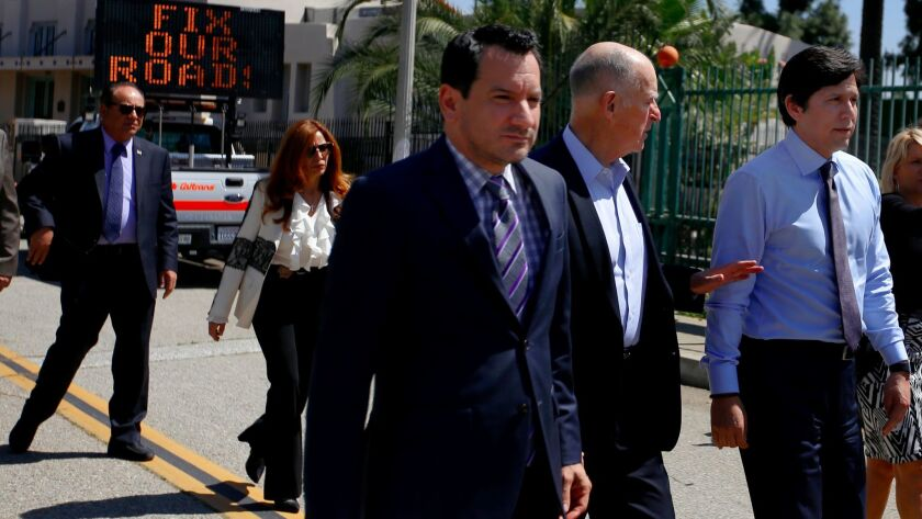 Assembly Speaker Anthony Rendon, from left, Gov. Jerry Brown and Senate President Pro Tem Kevin de León walk toward a news conference in Riverside on April 4, 2017.