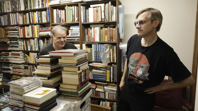 MAR VISTA, CA -- MARCH 29, 2018: David Benesty, left, manager of Sam: Johnson's Bookshop shows store