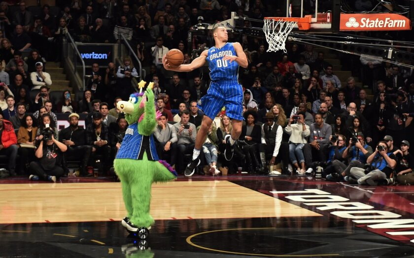 Orlando Magic forward Aaron Gordon slam dunks the ball during the NBA all-star skills competition in Toronto on Saturday, Feb. 13, 2016. (Mark Blinch/The Canadian Press via AP) MANDATORY CREDIT