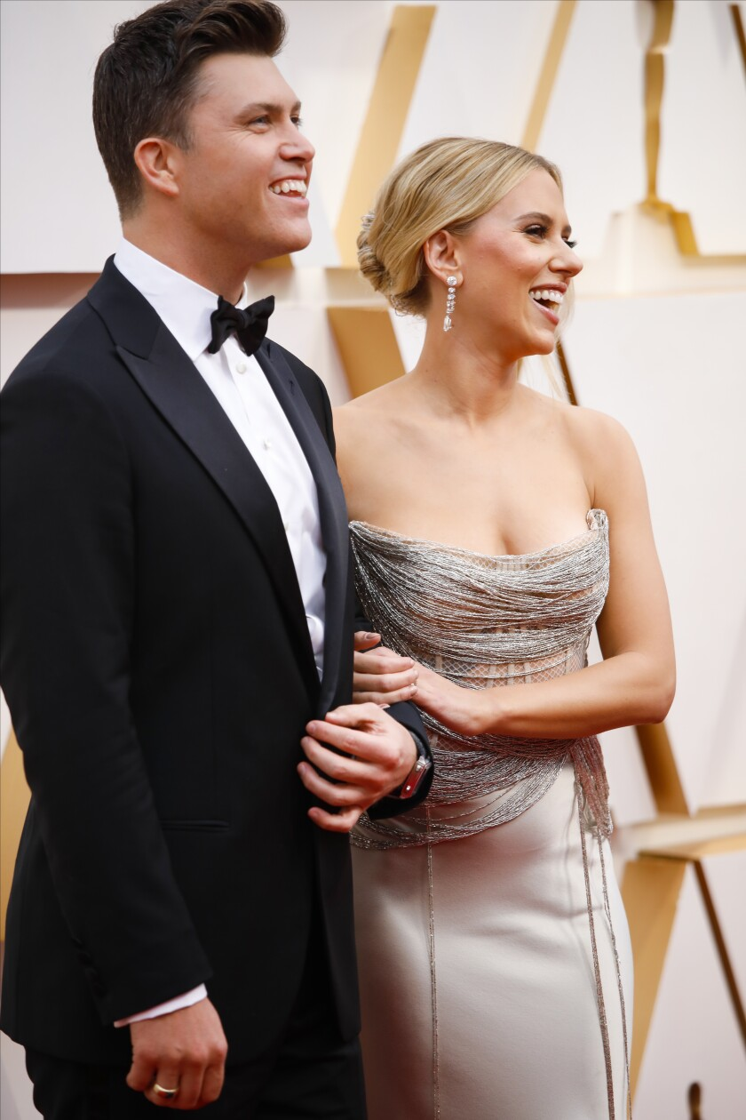 Colin Jost, left, and Scarlett Johansson