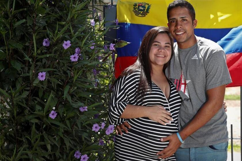 Reinaldo Perger walked and hitchhiked from Venezuela across five countries to Buenos Aires to be with his Venezuelan girlfriend Fabiola Navarro as she is about to have their baby; they are seen together again in this photo taken on Jan. 4, 2019. EFE-EPA/Juan ignacio Roncoroni