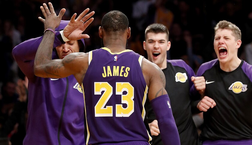 LOS ANGELES, CALIF. - DEC. 5, 2018. The Lakers bench reacts after forward LeBron James scores a ba