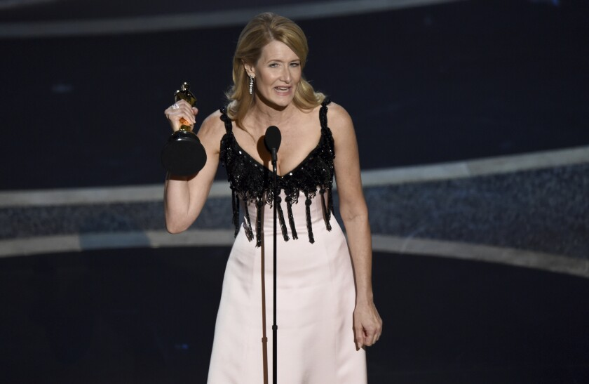 """Laura Dern accepts the award for best performance by an actress in a supporting role for """"Marriage Story"""" at the Oscars on Sunday, Feb. 9, 2020, at the Dolby Theatre in Los Angeles. (AP Photo/Chris Pizzello)"""