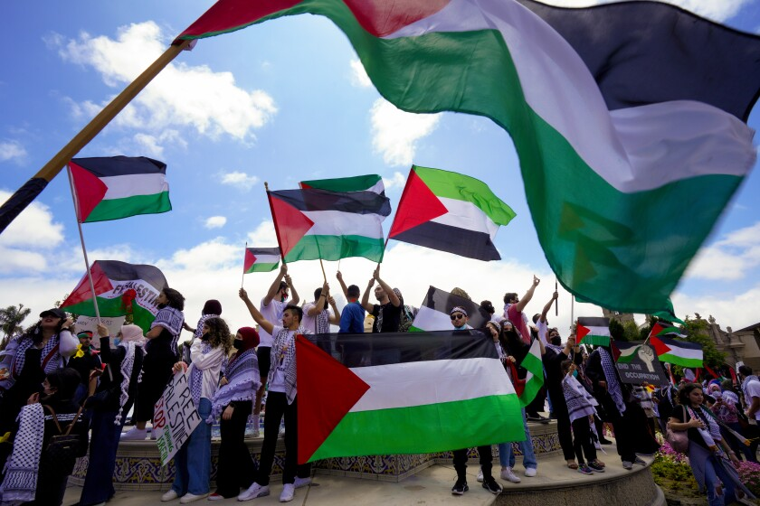 The Palestinian Youth Movement holds a rally and march at Balboa Park