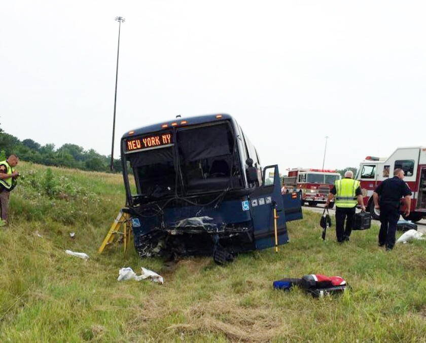 Emergency personnel respond to the scene of a bus accident on Interstate 70 near Richmond, Ind.