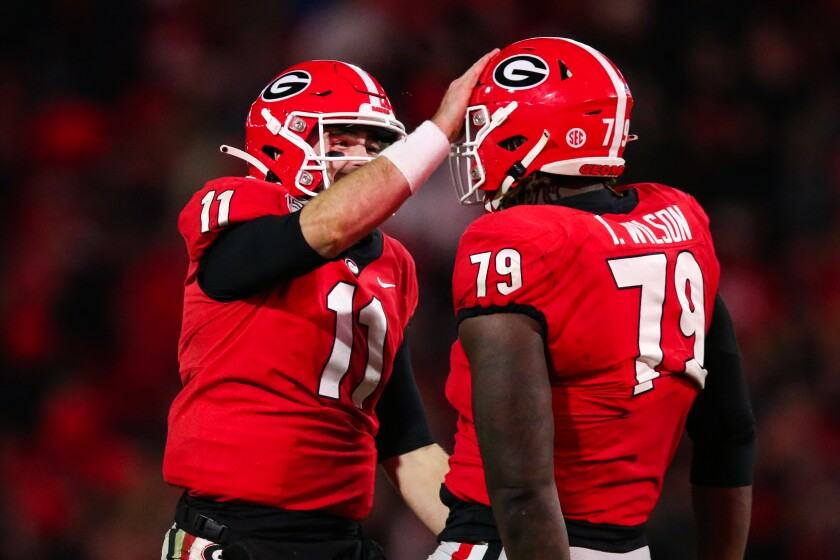 Georgia quarterback Jake Fromm (11) celebrates with Isaiah Wilson (79) during the second half against Missouri on Saturday. The Bulldogs have a big game Saturday against Auburn.