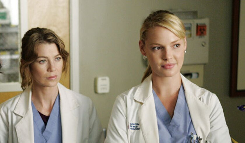 """Ellen Pompeo, left, and Katherine Heigl starred together on """"Grey's Anatomy."""" Pompeo spoke about Heigl's departure from the show in a New York Post interview."""