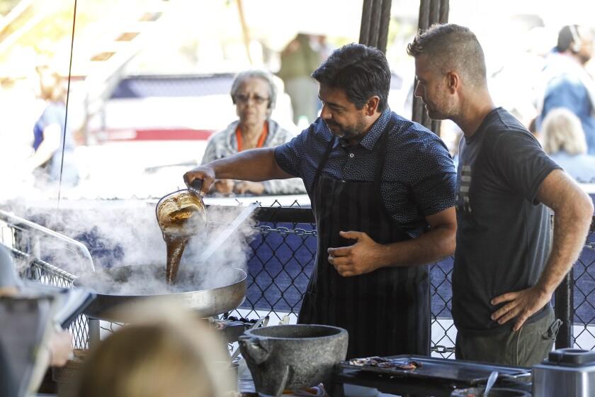 Local chef Javier Plascencia, left, cooks as host Pete Evans observes.