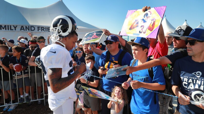 IRVINE, CALIF. -- MONDAY, AUGUST 13, 2018: Rams corner back Marcus Peters signs autographs for fans