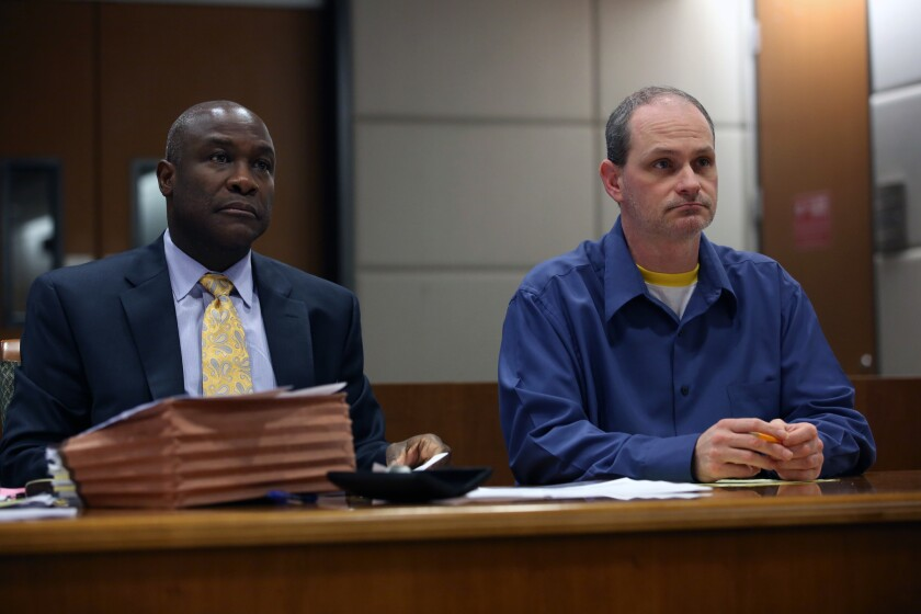 Nathan Louis Campbell, right, was sentenced to 42 years to life in prison. He is shown in court with attorney James Cooper III before the start of closing arguments.