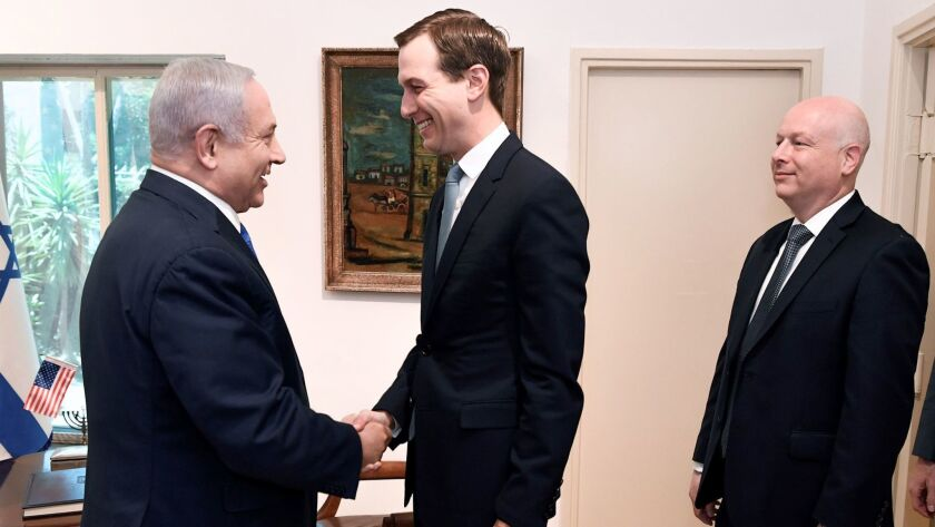 Jared Kushner shakes hands May 30 with Israeli Prime Minister Benjamin Netanyahu, as U.S. special representative for international negotiations Jason Greenblatt looks on.
