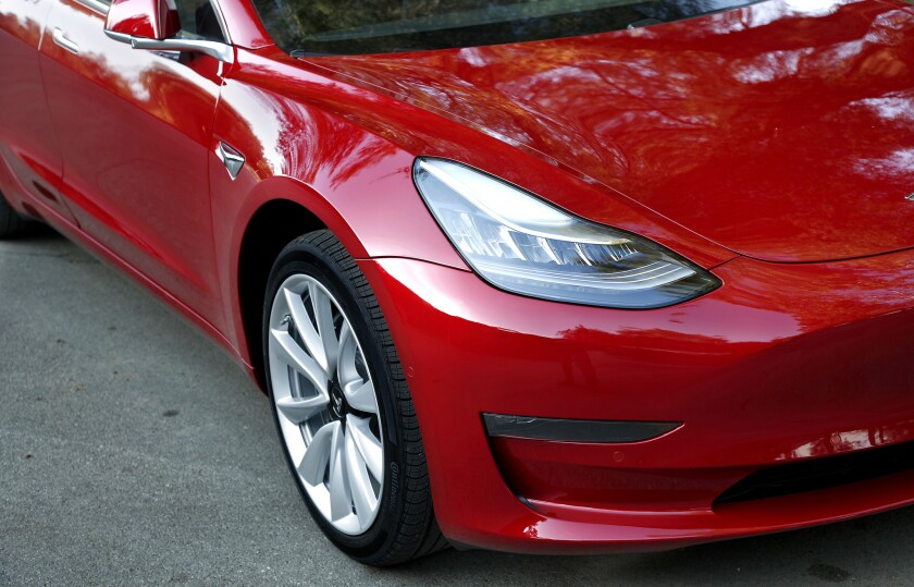 Tesla jumped to No. 11, the highest for any U.S. auto brand, in Consumer Reports' annual auto ranking. Its Model 3 sedan, above, was a top pick for the first time.