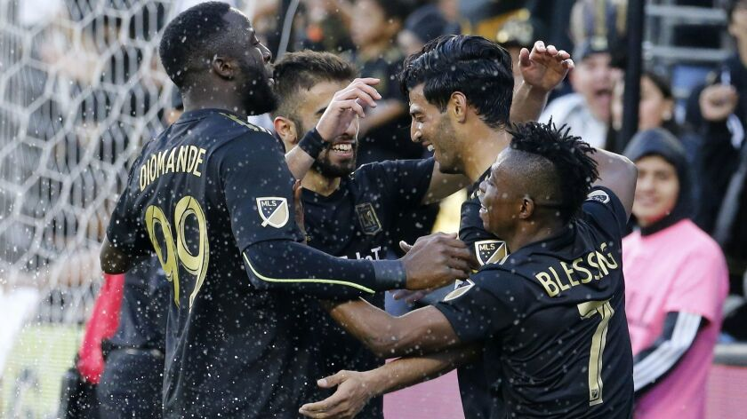 Los Angeles FC forward Carlos Vela, second from right, of Mexico, celebrates his goal with teammates