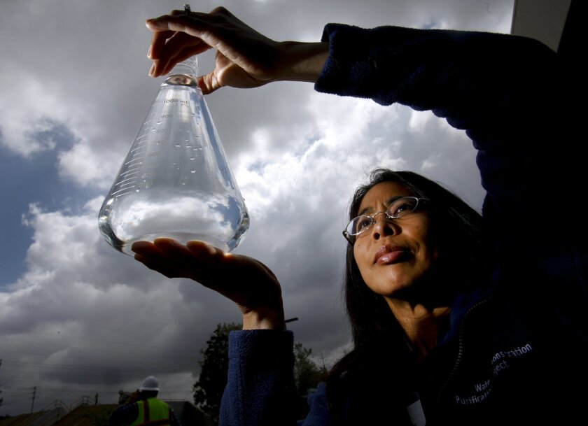 Amy Dorman, senior civil engineer with the city of San Diego's Public Utilities Department holds a  sample of water purified to the quality level of pure distilled water at the Advanced Water Purification Facility in University City at the North City Water Reclamation Plant.