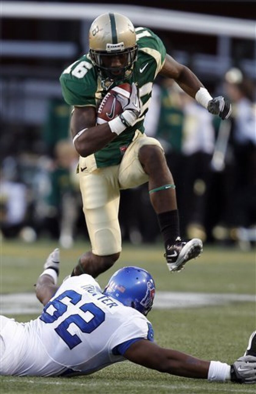 University Alabama Birmingham receiver Patrick Hearn (16) hurdles Memphis defensive end Frank Trotter (62) for extra yards during the first half of an NCAA college football game on Saturday, Nov. 20, 2010, in Birmingham, Ala. (AP Photo/Butch Dill)