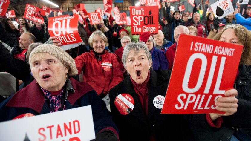 Opponents of a proposed oil-handling facility along the Columbia River in Washington state make their feelings known at a public hearing in January 2016. The state last week rejected the project.