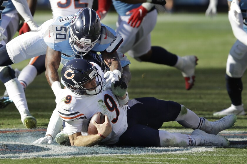 Tennessee Titans linebacker Derick Roberson (50) brings down Chicago Bears quarterback Nick Foles (9) in the second half of an NFL football game Sunday, Nov. 8, 2020, in Nashville, Tenn. (AP Photo/Ben Margot)