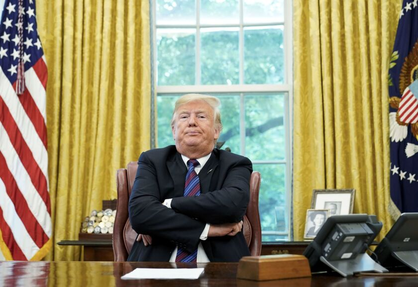 President Trump sits at the White House.