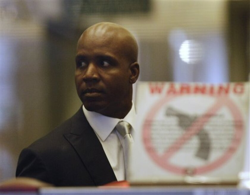 Barry Bonds arrives at the federal courthouse in San Francisco, Monday, March 21, 2011. The Bonds perjury trial is finally scheduled to get under way, more than three years after baseball's all-time home run leader was charged with lying to a federal grand jury when he denied knowingly taking performance-enhancing drugs.(AP Photo/Marcio Jose Sanchez)