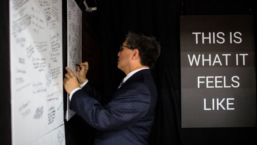 SAN DIEGO, CA - FEBRUARY 23: Democratic Gubernatorial candidate John Chiang writes on a board as par