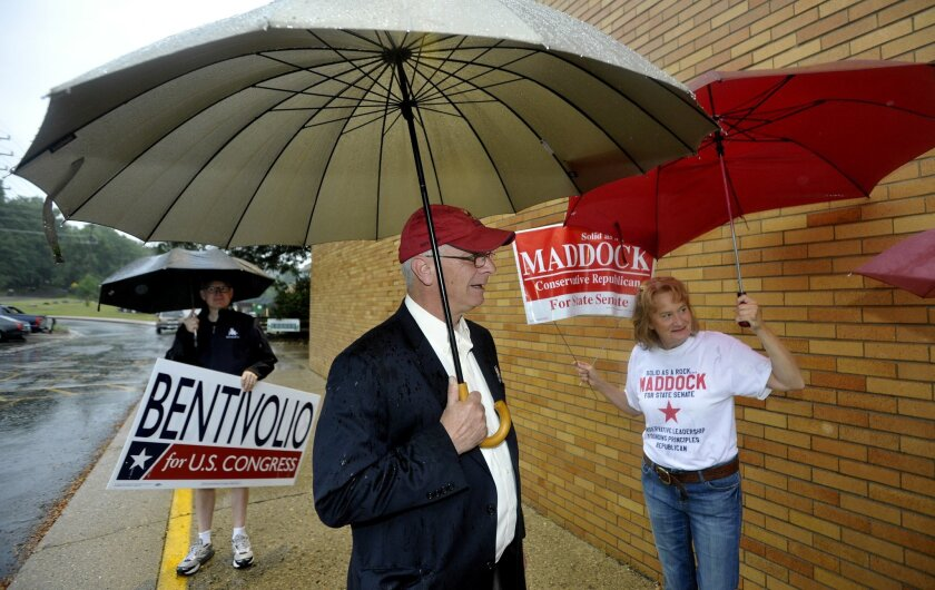 U.S. Congressman Kerry Bentivolio, center, talks with campaign volunteers, Tim Witt, left, 46, of Northville, and Vickie Kahle, right, 60, of Milford before voting in the Michigan primary on Tuesday, Aug. 5, 2014. (AP Photo/Detroit News, Todd McInturf ) DETROIT FREE PRESS OUT; HUFFINGTON POST OUT