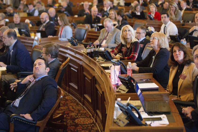 Kansas lawmakers watch as final votes are tallied Feb. 7 in Topeka. The House voted 80-43 against putting an antiabortion constitutional amendment on the ballot.