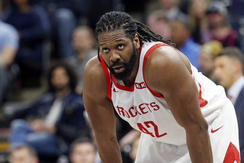 FILE - In this Feb. 13, 2019, file photo, Houston Rockets' Nene looks on during break in play against the Minnesota Timberwolves during an NBA basketball game in Minneapolis. The Hawks have requested waivers on center Nene, one day after he was acquired from Houston as part of a four-team trade. The Hawks on Wednesday, Feb. 5, 2020, also acquired center Clint Capela from the Rockets in the four-team trade involving 12 players. In the deal, Atlanta sent guard Evan Turner and a conditional 2020 first-round pick to Minnesota and a 2024 second-round pick to Houston. (AP Photo/Jim Mone, File)