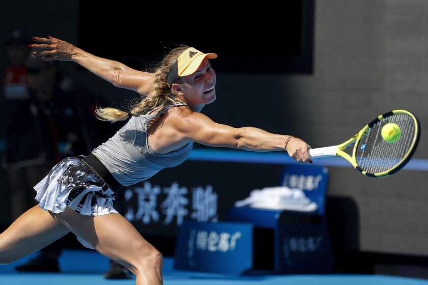 Caroline Wozniacki hits a return shot against Katerina Siniakova during their match at the China Open Oct. 3 in Beijing.