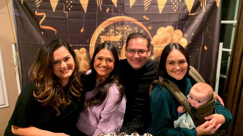 Luis Tovar is surrounded by his three daughters, Genevieve Raygoza, Thalia Tovar and Vania Tovar.